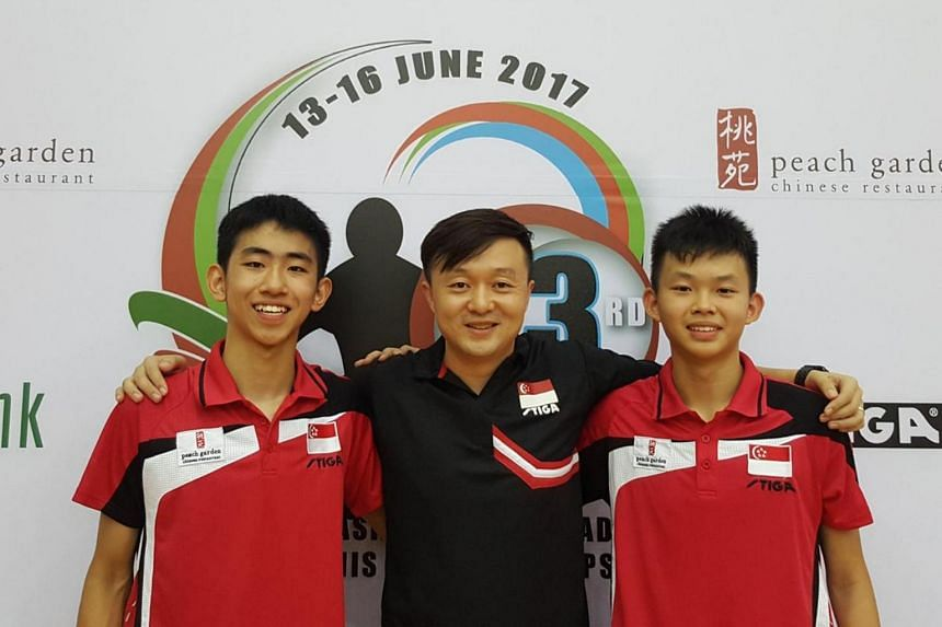 Singapore's Under-15 table tennis players Pang Yew En Koen (left) and Dominic Koh (right) won the Cadet Boys' Doubles at the South East Asia Junior & Cadet Table Tennis Championships on June 15.
