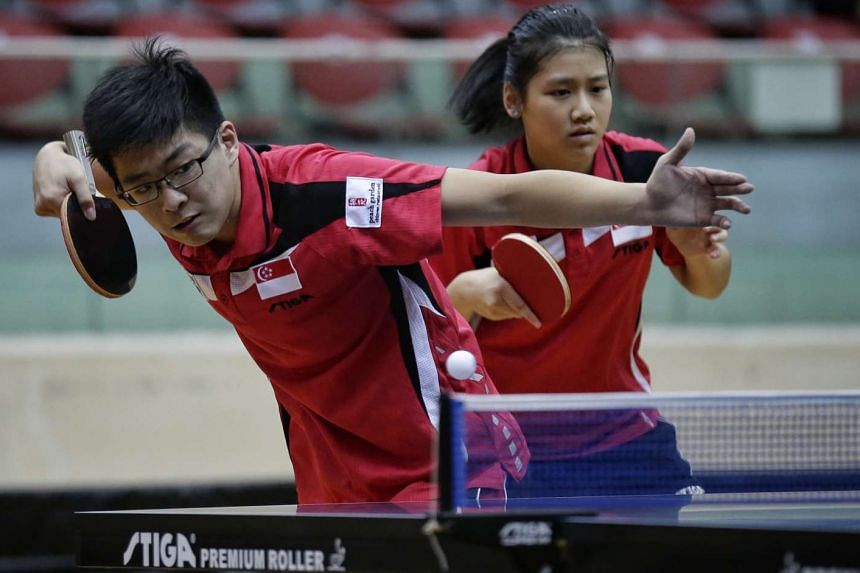 Singapore's Ethan Poh and Wong Xinru on their way to victory against compatriots Gerald Yu and Goi Ruixuan in the Junior mixed doubles finals of the 23rd South East Asian Junior and Cadet Table Tennis Championships at Toa Payoh Sports Hall on June 16
