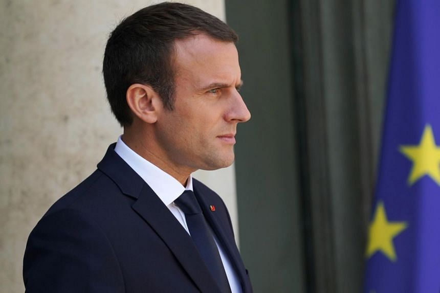 French President Emmanuel Macron waits for the arrival of the Spanish Prime Minister for a meeting at the Elysee Palace in Paris, on June 16, 2017.
