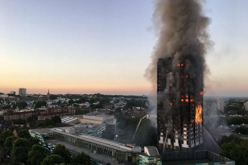 Flames and smoke emitting from a 27-storey block of flats after a fire broke out in Grenfell Tower, west London on June 14, 2017.