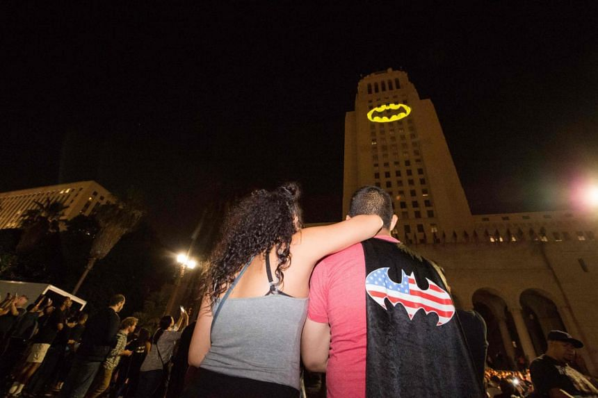 "The Batman ""Bat-signal"" is projected onto Los Angeles City Hall in a tribute to the late actor Adam West in Los Angeles, California on June 15, 2017."