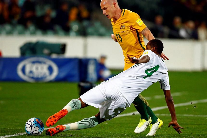Australia's Aaron Mooy and Saudi Arabia's Abdulla Aldossary in action during the World Cup 2018 Qualifiers match between Australia and Saudi Arabia on June 8, 2017.