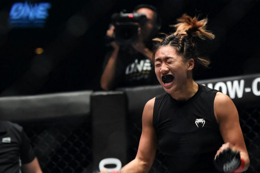 Singapore's Angela Lee celebrates after defeating Brazil's Istela Nunes during the Mixed Martial Art (MMA) One Women's Atomweight Championship on May 26, 2017 at the Indoor Stadium in Singapore.