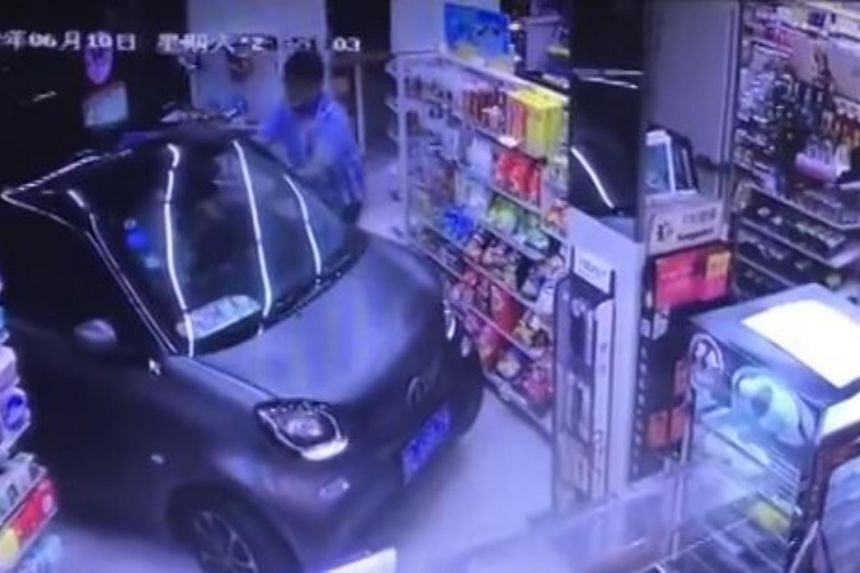 An absurd encounter was caught on camera when a grey car drove into a store in eastern China to purchase groceries on June 10, 2017.