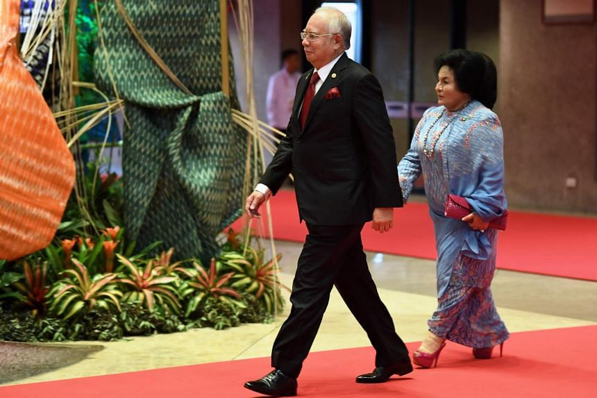 Malaysia's Prime Minister Najib Razak and his wife Rosmah Mansor arrive to attend the opening ceremony of the Asean leaders' summit in Manila on April 29, 2017.