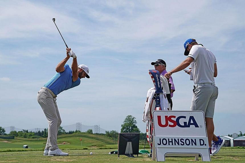 World No. 1 Dustin Johnson hitting a shot during a practice round at Erin Hills. Uncertainty over a possible penalty stroke lingered over the American at last year's US Open, putting the status of the leaderboard in doubt before he pulled away for an