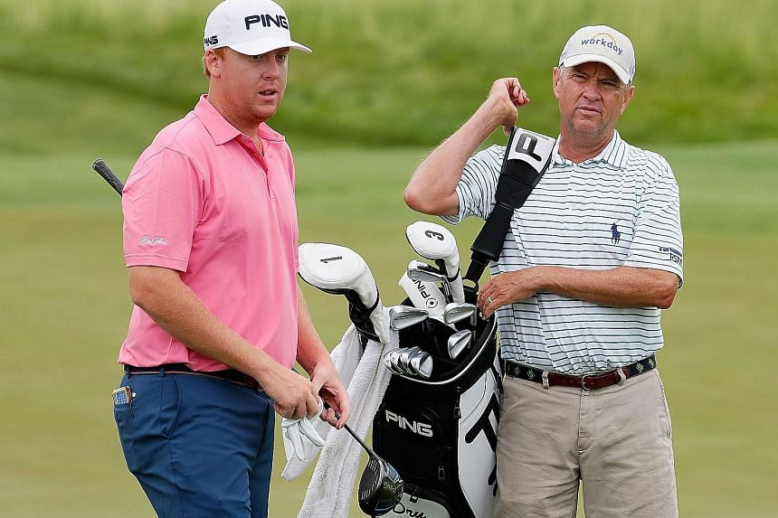 American golfer Dru Love (left) and his father Davis Love III working together during a practice round ahead of the US Open.