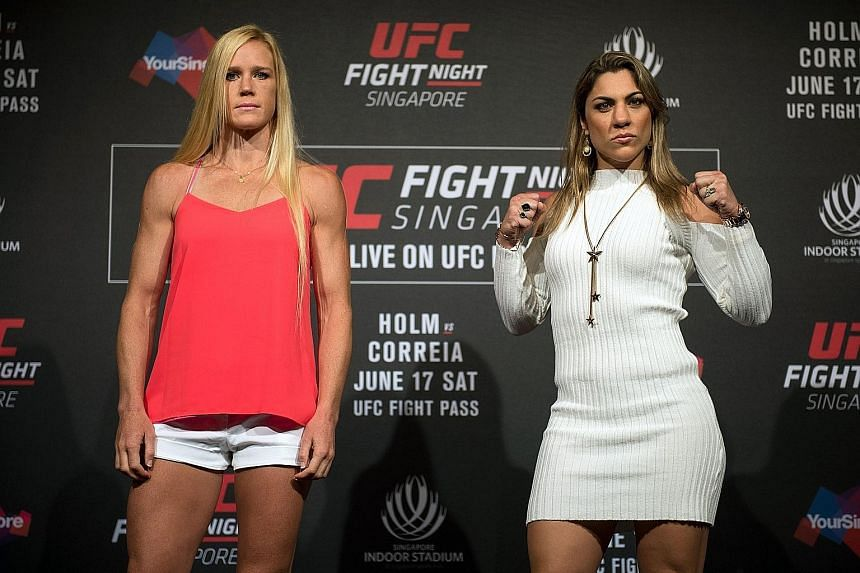 MMA fighters Holly Holm (left) and Bethe Correia face off before their main event in UFC Fight Night Singapore.