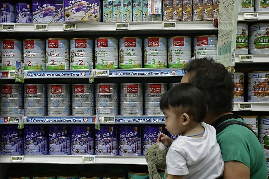 Australia's Own infant formula for sale at AMK Hub's FairPrice Xtra supermarket. It is priced at between $27.50 and $35 for a 900g tin, lower than the average price of $56.06.