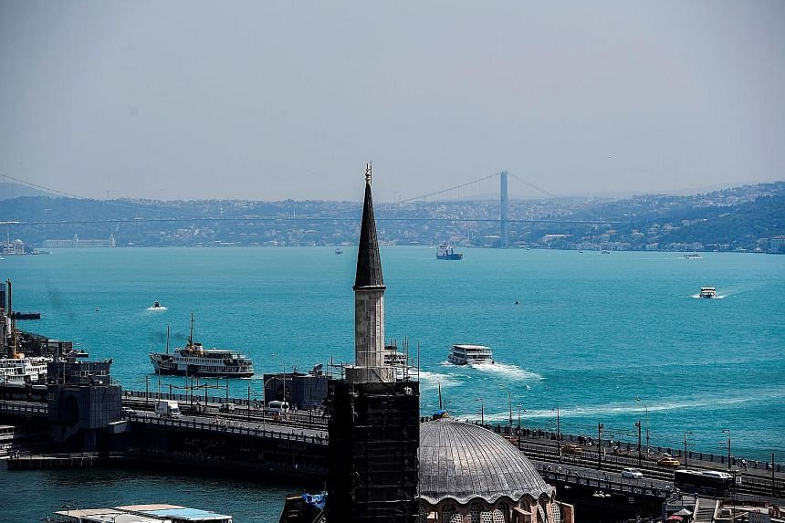 A view of the Bosphorus Strait on Wednesday after it turned turquoise due to a surge in a species of plankton across the Black Sea. The sudden transformation of Bosphorus' waters from its usual shade of blue to a milky turquoise since the weekend ala