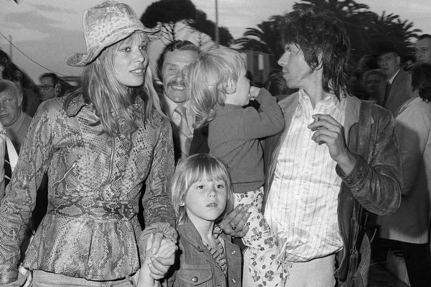 Rolling Stone guitarist Keith Richard (right), actress Anita Pallenberg, and their children arrive at for the 25th International Cannes film festival.