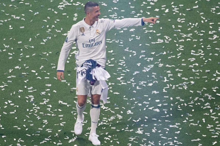 Real Madrid's Portuguese forward Cristiano Ronaldo during a celebration event held at the Santiago Bernabeu stadium after the team beat Juventus 4-1 in the Uefa Champions League final on June 3, 2017. At Real, he has won the Champions League three ti