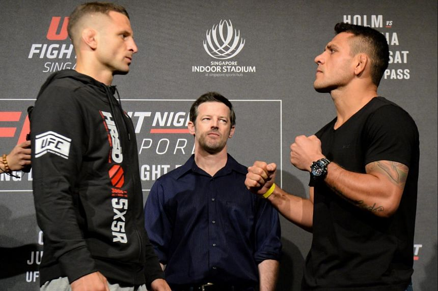 Tarec Saffiedine of Belgium (left) and Rafael dos Anjos of Brazil face off against each other during the UFC Fight Night media event in Singapore.