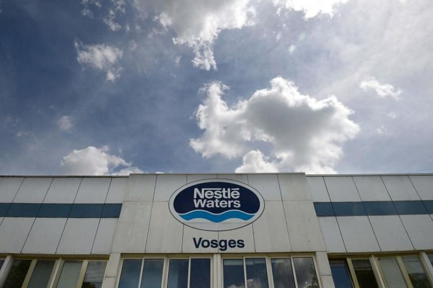 The Nestle waters' logo at the entrance to the factory is pictured at the water production plant in Contrexeville, eastern France on May 23, 2017.