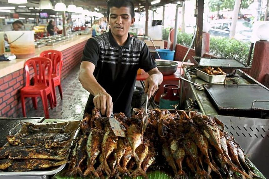 The ikan bakar (grilled fish) is a must-try at the famous food street, Jalan Raja Muda Musa.