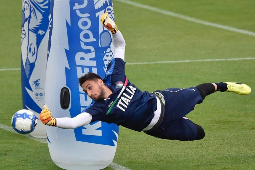 Gianluigi Donnarumma in action during a training session of the Italian national soccer team at Coverciano sport center, near Florence, Italy, on June 5, 2017.