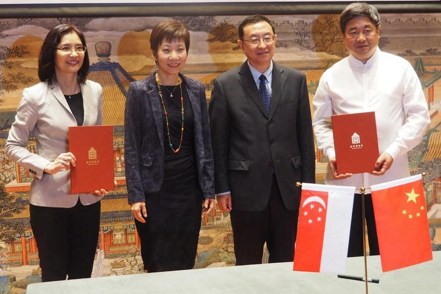 (From left) Ms Chang Hwee Nee, NHB's chief executive, Ms Grace Fu, Singapore's Minister for Culture, Community and Youth, Mr Luo Shugang, Minister for Culture for the People's Republic of China, and Dr Shan Jixiang, Palace Museum director, at the sig