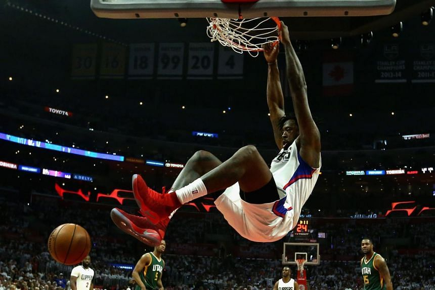 DeAndre Jordan of the Los Angeles Clippers dunks the ball during Game Seven of the Western Conference Quarterfinals against the Utah Jazz at Staples Center in Los Angeles, California on April 30, 2017.