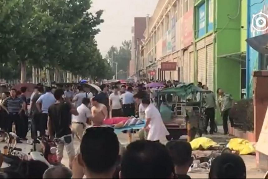 A victim being rushed to the hospital following a blast on Thursday afternoon outside a kindergarten in Xuzhou.