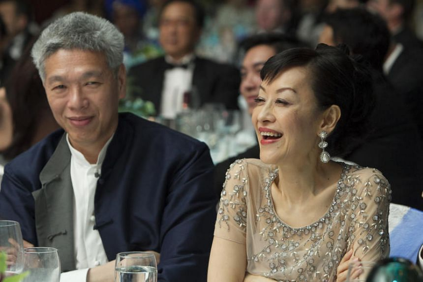 """Prime Minister Lee Hsien Loong said that his sister Lee Wei Ling once had """"grave suspicions"""" that the removal of her extra share was instigated by her brother Lee Hsien Yang (left) and his wife Lee Suet Fern (right)."""