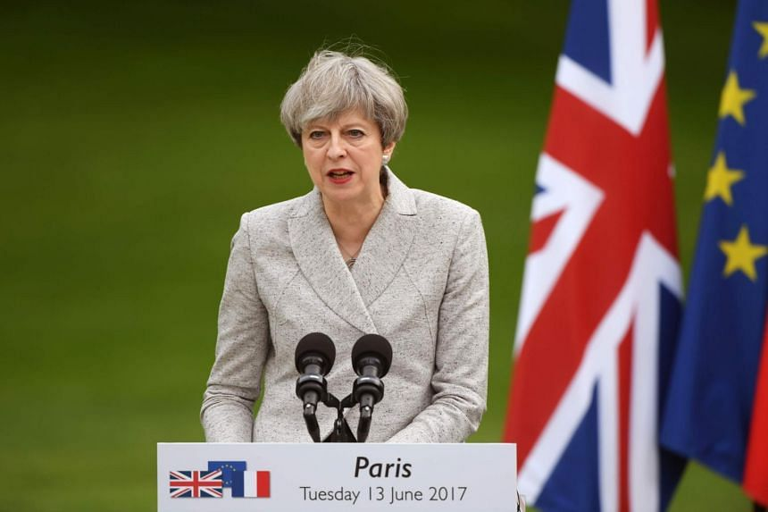 Britain's Prime Minister Theresa May speaks during a joint press conference with the French prime minister.