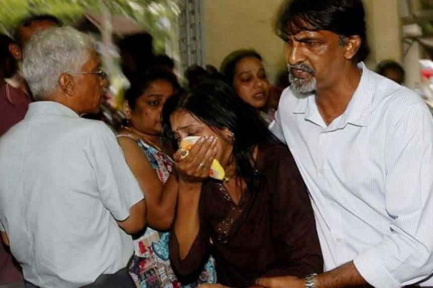 D. Shanti being consoled by a relative, after she found out that her son Nhaveen had died at Penang Hospital.