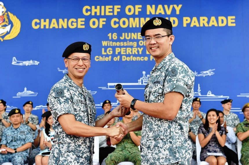 Rear-Admiral (RADM) Lew Chuen Hong (right) took over the Navy's symbol of command from the outgoing chief, RADM Lai Chung Han on June 16, 2017.