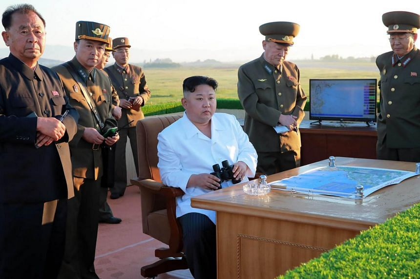 North Korean leader Kim Jong Un (centre) inspecting the test of a new anti-aircraft guided weapon system.