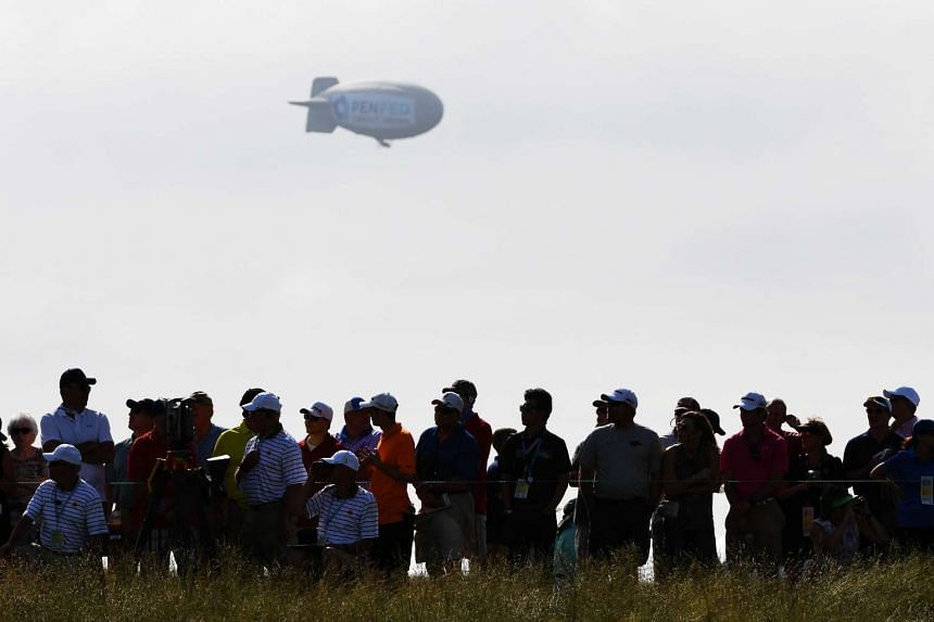 A blimp floats over the crowd during the first round of the 2017 US Open.