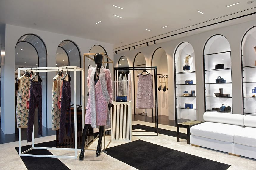 The boutique's contemporary Art Deco-inspired interior borrows from the brand's signature palette of black, white and beige.