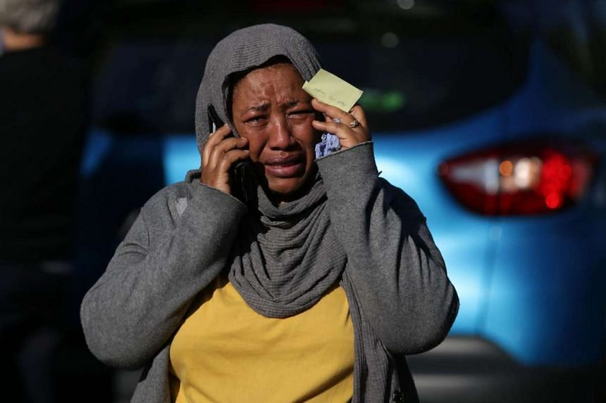 A woman cries as she tries to locate a missing relative suspected of being affected by the massive fire that engulfed Grenfell Tower, a residential block on June 14, 2017 in west London.