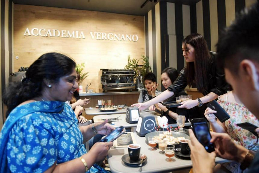 Participants sample coffee at Caffe Vergnano on June 17, 2017.