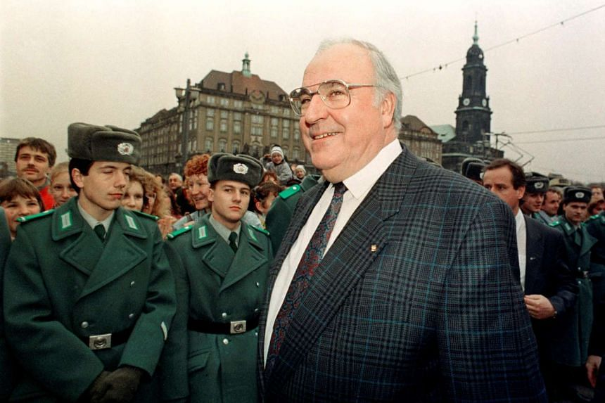 German Chancellor Helmut Kohl smiles during a 1989 visit to Dresden.