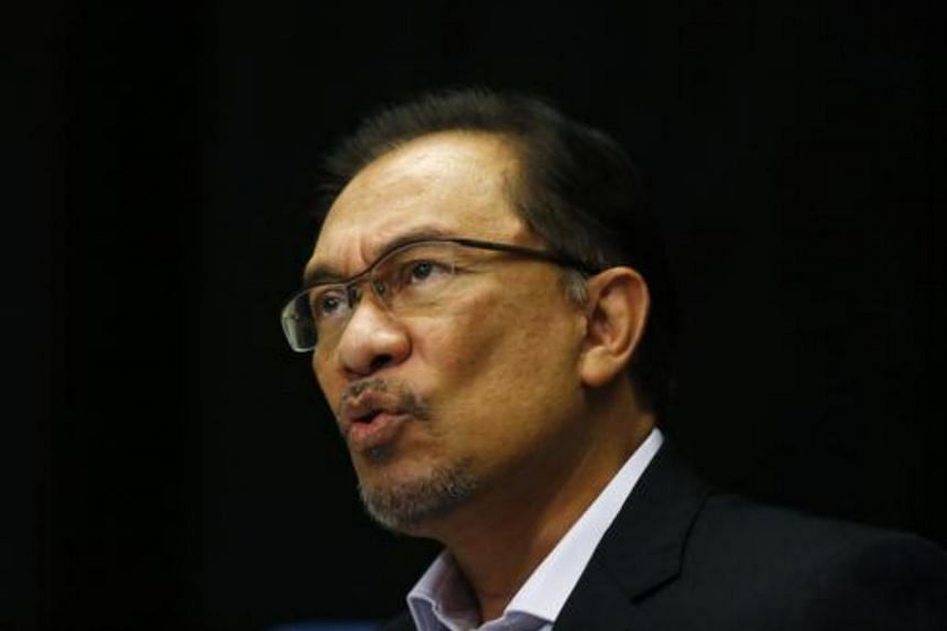 Malaysia's opposition leader Anwar Ibrahim speaks to the media ahead of the verdict in his final appeal against a conviction for sodomy in Kuala Lumpur on Feb 4, 2015.