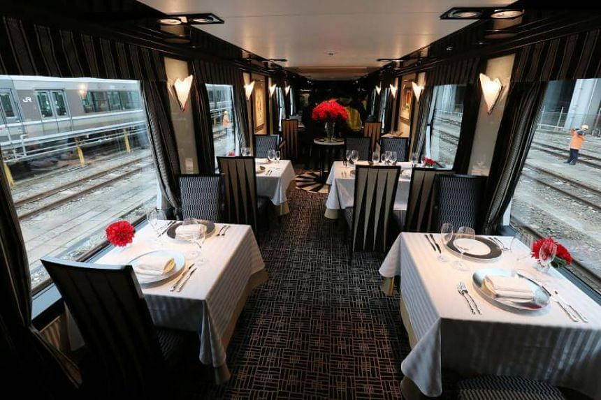 """A dining car of Japan's latest super-deluxe cruise train """"Twilight Express Mizukaze"""" during its press preview in Osaka, on Feb 23, 2017."""