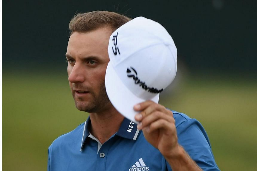 Dustin Johnson reacts after finishing on the 18th green during the second round of the 2017 U.S. Open at Erin Hills in Hartford, Wisconsin on June 16, 2017.