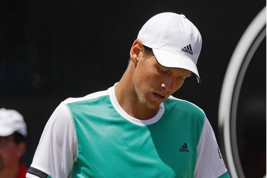 Tomas Berdych shows his dejection after losing against Feliciano Lopez in their quarter final match at the ATP Mercedes Cup in Stuttgart, on June 16, 2017.