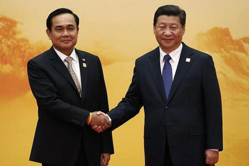 Thai Premier Prayut Chan-o-cha (at left) with Chinese President Xi Jinping at the Asia-Pacific Economic Cooperation forum in 2014. Bangkok is strengthening its ties with Beijing.