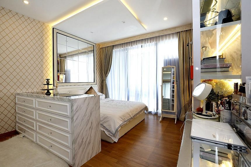 The living (top) and dining (above) areas stick to a black-and-white palette for a cohesive feel. Cove lighting and parquet flooring add to the warm ambience of the master bedroom (left), and in the children's rooms, solid colours, such as blue (righ