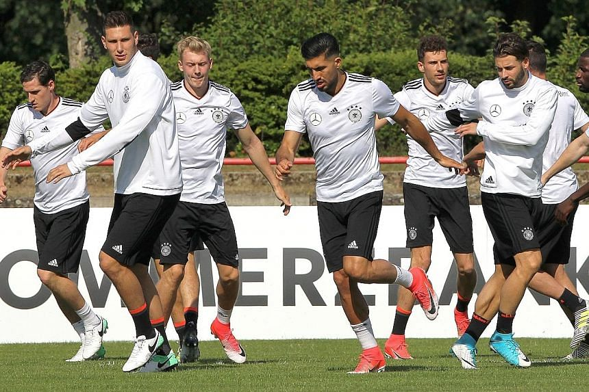 Germany's players at a training session in Keltersbach, near Frankfurt, on Tuesday. Coach Joachim Low says his focus is long-term and that he aims to strengthen his squad for next year's World Cup.