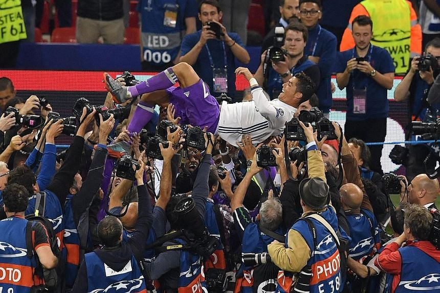 Real Madrid forward Cristiano Ronaldo celebrating after winning the Champions League final against Juventus on June 3. Should Ronaldo choose to leave Real, only top-tier clubs with deep pockets like Manchester United or Paris Saint-Germain will be ab