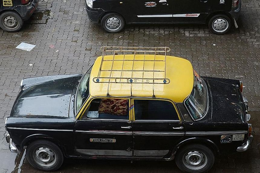 About 65,000 Padminis (foreground) plied Mumbai's roads at their peak in the mid-1990s, but only about 300 are left.