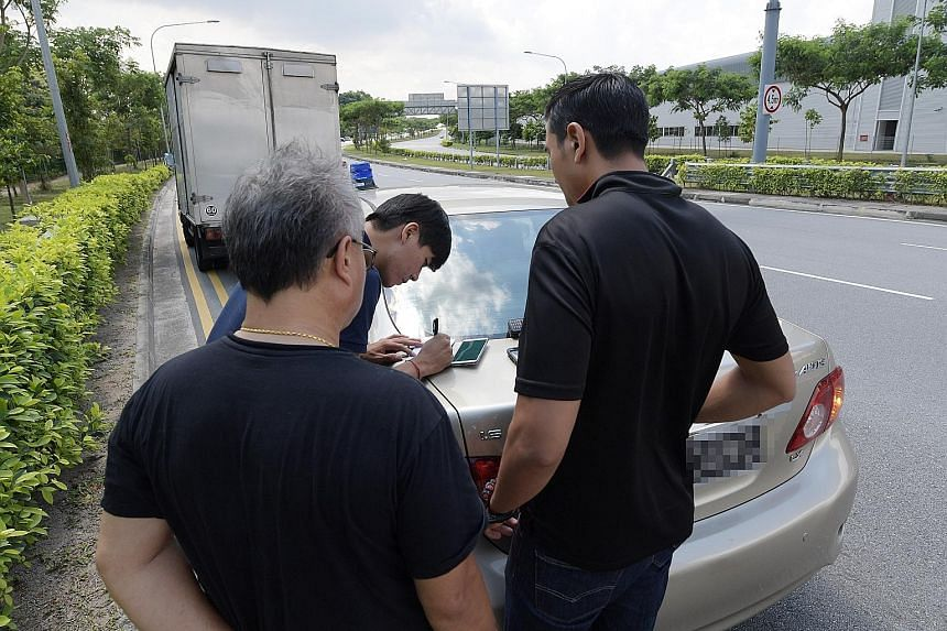 A lorry driver caught using his mobile phone while driving along the Central Expressway, during the Traffic Police's enforcement operations against heavy vehicle drivers yesterday, which resulted in 62 summonses being issued against 28 drivers.