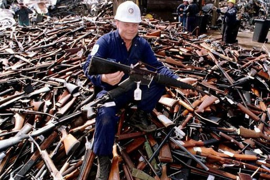 A security firm supervisor with an armalite rifle - similar to the one used in the 1996 Port Arthur massacre - and other weapons handed in to be scrapped in the aftermath of the mass shooting. The new national amnesty, which will run from July 1 to S