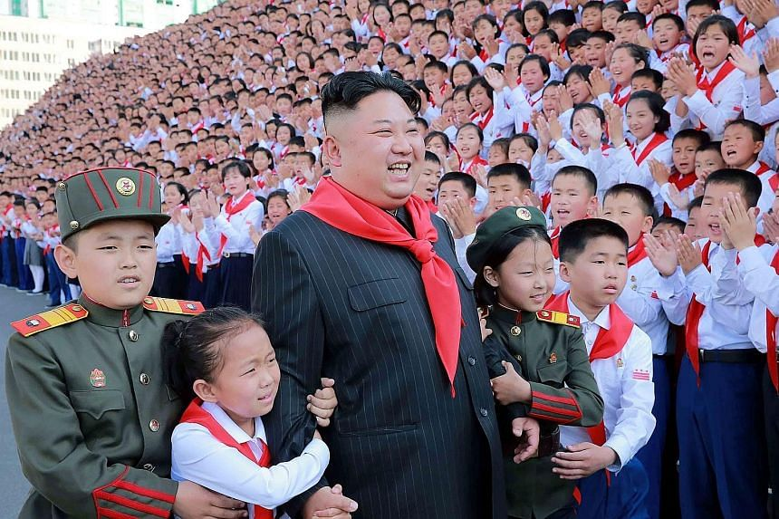 North Korean leader Kim Jong Un basking in applause at the 8th Congress of the Korean Children's Union in Pyongyang earlier this month.