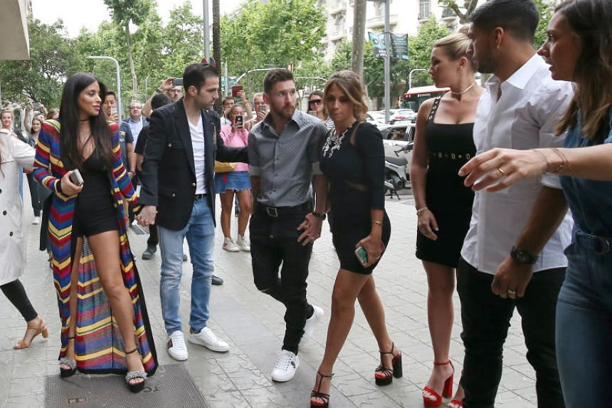 Barcelona talisman Lionel Messi with wife-to-be Antonella Roccuzzo, Barcelona forward Luis Suarez and his wife Sofia Balbi and Chelsea midfielder Cesc Fabregas and his girlfriend Daniella Semaan at a commercial event in Barcelona, Spain.