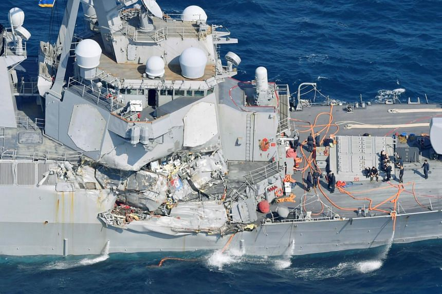 The Arleigh Burke-class guided-missile destroyer USS Fitzgerald, damaged by colliding with a Philippine-flagged merchant vessel, is seen off Shimoda, Japan, on June 17, 2017.