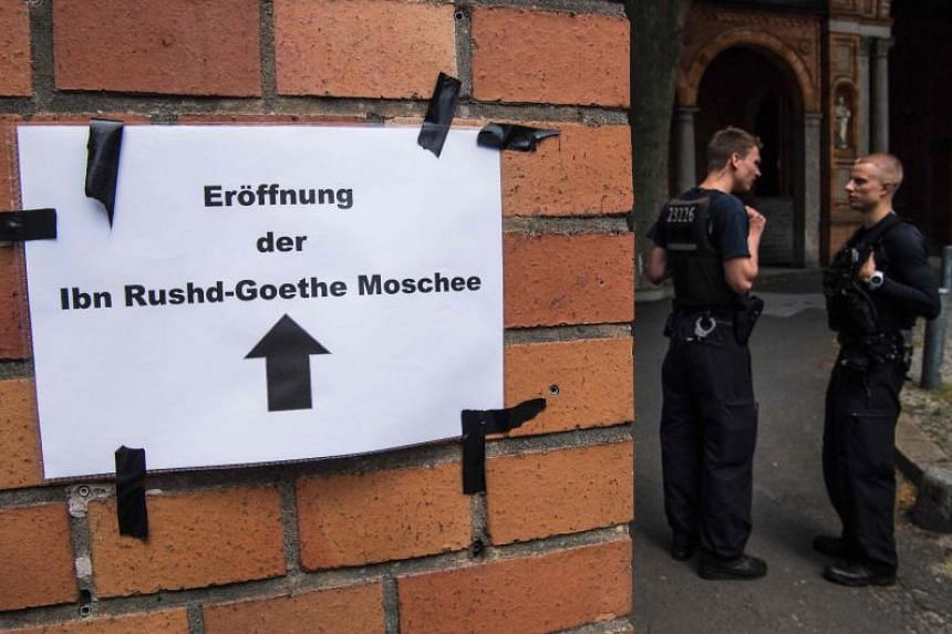 Police officers posted at the entrance of the Ibn Rushd-Goethe-mosque in the St. Johannis Protestant church in Berlin, on June 16, 2017.