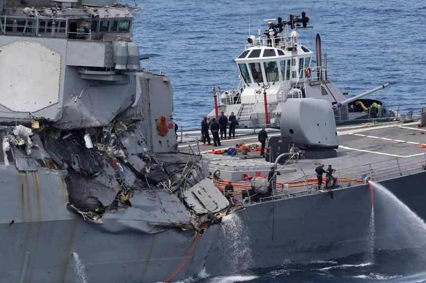 This picture shows damages on the guided missile destroyer USS Fitzgerald off the Shimoda coast after it collided with a Philippine-flagged container ship on June 17, 2017.
