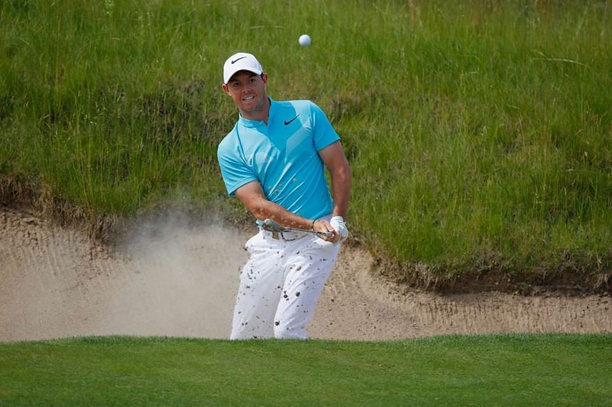McIlroy plays his shot from the bunker on the 16th hole during the second round.